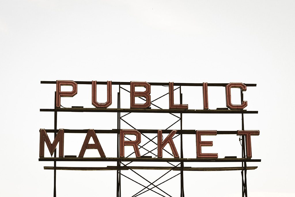 A photograph of a big sign which says 'PUBLIC MARKET'